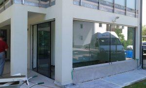 Frameless door system
