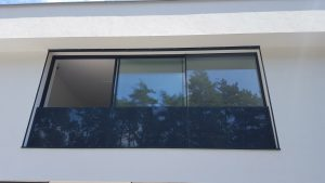 Outside view of Iframe Frameless Doors and Glass Fence