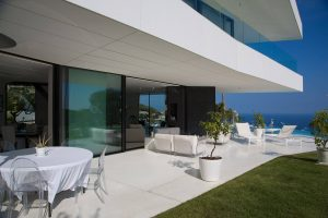 Outside view of frameless windows and doors in Villa Golden Eye