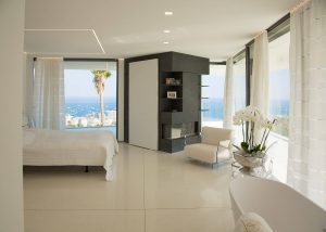 Inside view of frameless windows and doors in Villa Golden Eye