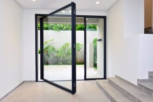 Minimalist frameless pivot doors